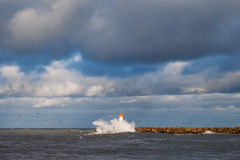 Breakwater in storm. Stock Photos