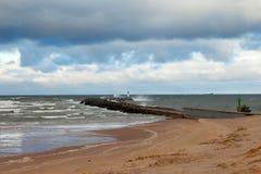 Breakwater in storm. Stock Images