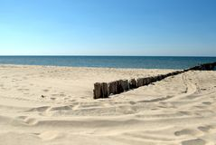 Breakwater and sunny beach. Wooden breakwater on a sunny beach - baltic see Stock Images