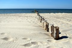 Breakwater and sunny beach Royalty Free Stock Images