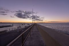 Breakwater sunrise calm Royalty Free Stock Photography