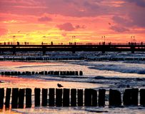 Breakwater and sunset Stock Photos