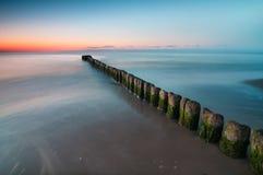 Breakwater Sunset Royalty Free Stock Photos