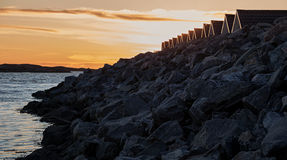 Breakwater at sunset. Royalty Free Stock Image