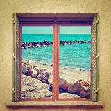 Breakwater. Surreal View of Breakwater through the Window, Instagram Effect royalty free stock image
