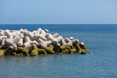 Breakwater of tetrapods at the Atlantic coast of Madeira, Portugal. Breakwater of concrete tetrapods at the Atlantic coast of Madeira, Portugal Stock Photo