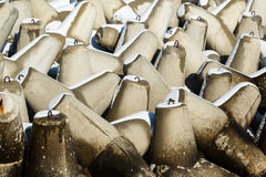 Breakwater tetrapods background with melting snow Royalty Free Stock Photos