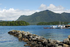 Breakwater in tofino. Summer view of mountains, sea and breakwater in small town tofino at pacific rim national park, british columbia canada royalty free stock photography
