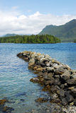 Breakwater in tofino. Summer view of mountains, sea and breakwater in small town tofino at pacific rim national park, british columbia canada stock photo