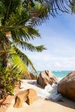 Breakwater at tropical beach Royalty Free Stock Photo