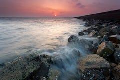 Breakwater waves Stock Photography