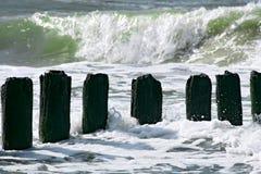 Breakwater and wavy ocean. Stock Photo
