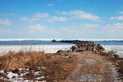Breakwater in icy Baltic sea. Royalty Free Stock Photo