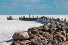 Breakwater in icy Baltic sea. Royalty Free Stock Photography
