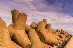 Breakwaters against the cloudy sky. On the beach Wladyslawowo Poland Stock Images