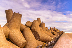 Breakwaters against the cloudy sky Stock Image