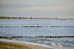 Breakwaters in the Baltic sea over the sunset Royalty Free Stock Photography