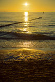 Breakwaters in the Baltic sea over the sunset Royalty Free Stock Photo