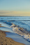 Breakwaters in the Baltic sea over the sunset Royalty Free Stock Images