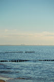Breakwaters in the Baltic sea over the sunset Stock Photography