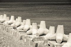 Breakwaters on the bank sea in beige tones Royalty Free Stock Photography