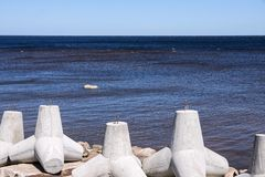 Breakwaters on the bank sea closeup Royalty Free Stock Image