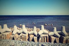 Breakwaters on the bank sea in a retro tones Royalty Free Stock Image
