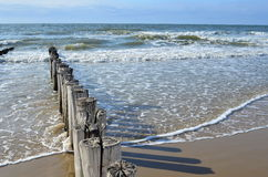 Breakwaters on the beach at the north sea in Domburg Holland. Breakwaters in waves on the beach at the north sea in Domburg Holland stock photography