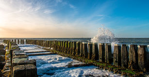 Breakwaters. With a colourful sky Royalty Free Stock Images