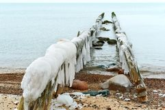 Breakwaters covered with ice, ice on breakwaters in the sea. Ice on breakwaters in the sea, breakwaters covered with ice stock images