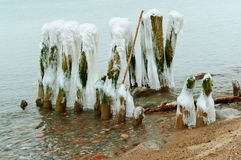 Breakwaters covered with ice, ice on breakwaters in the sea. Ice on breakwaters in the sea, breakwaters covered with ice royalty free stock images