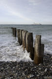 Breakwaters North-sea France. Breakwaters and ferry-boat on Channel France Stock Images