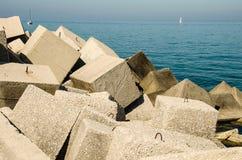 Breakwaters in the sea. Breakwaters in the Adriatic sea in Italy stock image