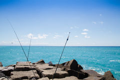 Breakwaters, sea and blue sky and fishing rods Royalty Free Stock Image