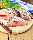 Bream crude pieces with knife on board Royalty Free Stock Photos