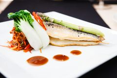 Bream fish with vegetables Royalty Free Stock Image
