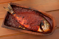 Bream fish baked in roof tile Stock Images