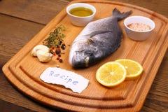 Bream fish on cutting board, recipe label Stock Photography
