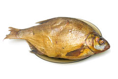 Bream fish smoked on a plate on a white background Stock Photos
