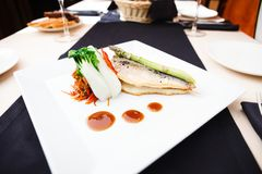 Bream fish with vegetables Stock Photo