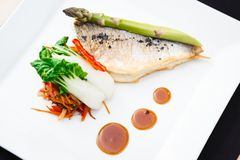 Bream fish with vegetables Stock Image