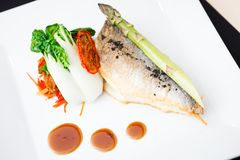Bream fish with vegetables Royalty Free Stock Photography