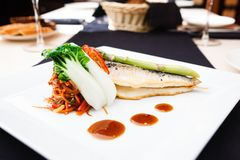 Bream fish with vegetables Royalty Free Stock Photos