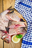 Bream raw on board with a knife and napkin Royalty Free Stock Images