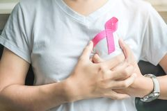 Breast Cancer Awareness. Pink Ribbon for supporting people living and illness. Woman Healthcare and World cancer day concept royalty free stock photo