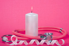 Breast Cancer Awareness Ribbon with Candle Flame Stethoscope. Breast Cancer Awareness theme, burning light pink candle with stethoscope wrapped around it pink Stock Images