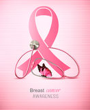 Breast cancer awareness ribbon on a pink background. Stock Photos
