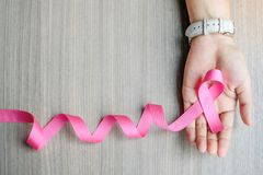 Breast Cancer Awareness. Woman hand holding Pink Ribbon for supporting people living and illness. Women Healthcare and World cancer day concept stock images