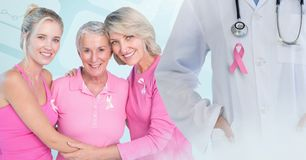 Breast cancer doctor and women with pink awareness ribbons. Digital composite of Breast cancer doctor and women with pink awareness ribbons Stock Image
