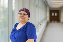 Breast Cancer Patient Wearing Hair Cap. Woman diagnosed with cancer wearing a fashionable hair cap Stock Photos